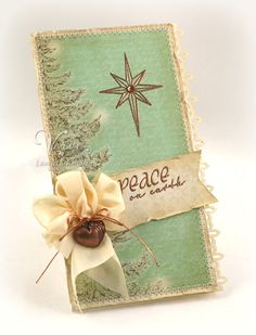 Shabby Peace On Earth Card...with inked papers & bow with metal heart.