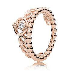 A design like a crown ring http://www.ringsjewelry.co.uk/pandora-rose-my-princess-tiara-ring-180880cz.htm