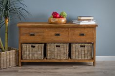 This stunning reclaimed teak storage unit is an elegant addition to your hallway, dining room or any other area of the house where you require an attractive yet very functional piece of furniture. Made from solid reclaimed Teak using traditional joinery methods and with a rustic hand sanded finish. The natural Kubu wicker baskets sit very comfortably beneath the large drawers.