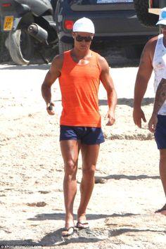 Cristiano Ronaldo wearing Diesel Sandy-S Swim Shorts in Navy and Nike Dri-Fit Touch Tank in Electro Orange/Team Orange/Black Cristiano Ronaldo Style, Cristiano Ronaldo Cr7, World Best Football Player, Star Fashion, Mens Fashion, Orange Vests, Bikini Clad, Sports, Moda Masculina