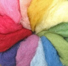 Organic wool plant-dyed fleece that is simply magical! Beautiful soft colors of natural dyes. Fun filled colors to place in a basket of your family's sewing needs. An enchanting fiber for felting, making fairy fleece dolls, whimsical hair on table puppets and peg dolls.  A favorite for painting magic wool pictures - layer wisps of fairy wool onto a wool felt or flannel background as instructed in the classic, Magic Wool.  Large bag, 100 grams (3.5 oz), 12 assorted colors. $15