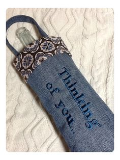 Recycled denim!  Wine Bag Embroidered with Thinking of You. This plus an amazing bottle of wine.... = love ;-)