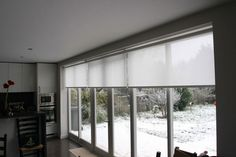 Voile natural roller blinds diffuse the light beautifully in this kitchen