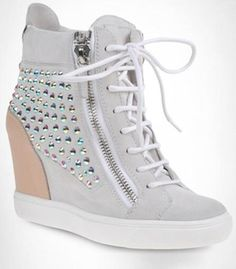 High-top sneakers in white suede and sand calfskin with a concealed platform, two zippers at sides and iridescent rhinestones. Youthful and casual, these sneakers are perfect for both daytime and evening, paired with a miniskirt or hot pants. High Top Sneakers, Sneakers Mode, Sneakers Fashion, Fashion Shoes, Shoes Sneakers, Sneakers Style, Hidden Wedge Sneakers, Women's Fashion, Girls Shoes
