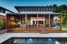 At the rear of the house, the existing addition was replaced with a pavilion that serves as an outdoor room, opening to the pool.