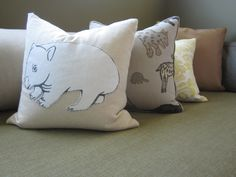 Some hand drawn animals appliquéd to a simple linen pillow.