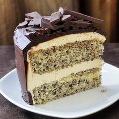 """Tweed Cake - a vanilla cake flecked with grated chocolate for the """"tweed"""" effect and topped with vanilla buttercream frosting before a finish of chocolate ganache. Based on a favorite Newfoundland childhood cookie square."""