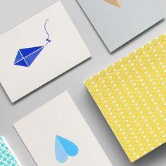 Kite print card in dark blue in stone | heart print card in light blue on stone | dash print layflat notebook in leaf green #paper #pattern #simple by ola_studio