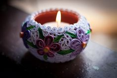Quilling on candle holder.