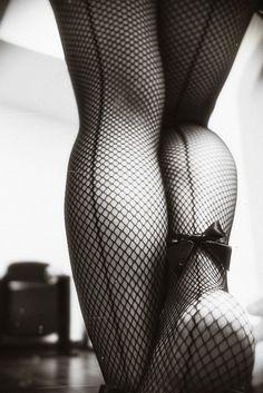 back seam fishnet stockings & bow...love it!!