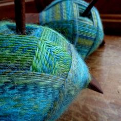 Above Board: off the tiny travel spindle and plied on two bigger spindles!  I find blues and greens so soothing.  #handspun #threewatersfarm #twfmar16 #turkishspindle #aboveboard #spinnersofinstagram #spindlespun by mmbmeek