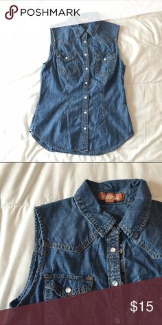 Sleeveless Denim Button Up Shirt Medium wash and sleeveless, denim button up shirt. Snap button closure. F21 Premium Denim. Two shirt pockets, one on each side. Worn a handful of times; in great condition. Make an offer! Forever 21 Tops Button Down Shirts