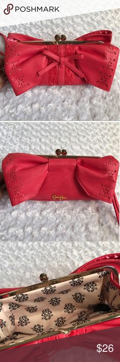 "JESSICA SIMPSON RED PINK WRISTLET CLUTCH BAG BIG BOWS on each side. Faux leather. Gold tone hardware. The back side has a ribbon bow with lace underneath. Add this POP of color to any drab outfit for an instant kick. Kiss lock. Perforated flowers on the bows. Length 10"" Height 5"" Depth 1.5"". Man Made materials. NWOT Jessica Simpson Bags Clutches & Wristlets"