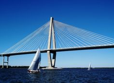 The beautiful Arthur Ravenel Bridge opened during a week-long celebration in July 2005. It is an eight-lane, cable-stayed bridge with two diamond shaped towers that allow clearance for modern ocean freighters to access the Port of Charleston.