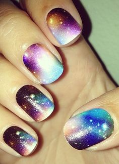 Galaxy Nail Art. A lot more complex and detailed then the one I did, but still want to try this one at some point.