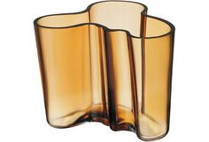 Designed in 1936 by famous architect Alvar Aalto this vase has become an icon of Finnish design and one of the world's most famous glass objects.