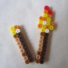 Perler Minecraft Torches. $1.75, via Etsy.