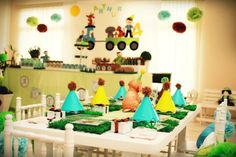 Puppy Dog Birthday Party  This PUPPY DOG BIRTHDAY PARTY submitted by Alessandra Rosa of Rose Ale Party Planners will melt your heart. I love the turquoise, yellow, green and brown color scheme. The doggie bags, doggie treats, dog hats, paw prints, grass and silver buckets are my favorite!