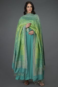 From our exclusive collection of Benaras Threads, this is a green-turquoise rangkat dye Banarasi zari hand woven pure monga georgette dupatta. The dupatta has gold diagonal zari weave all over with gold zari weave borders all around and resham-za Anarkali Dress, Pakistani Dresses, Indian Dresses, Indian Outfits, Sari Dress, Ethnic Outfits, Dress Skirt, Indian Attire, Indian Wear