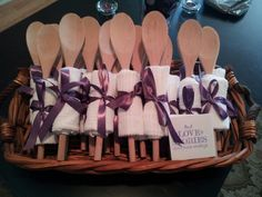 Kitchen Theme Bridal Shower Gifts!  Easy and cost efficient to make. Wooden spoon wrapped in a dish cloth... and useful to!