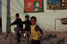Boys play on a street in the Alawi neighbourhood of Baghdad, Iraq.  UNICEF continues to support education, child protection and health initiatives in Iraq. UNICEF is also helping to teach children about the risks associated with mines and explosive remnants of war and supports relief efforts for vulnerable Iraqi refugees abroad.  © UNICEF/Kamaran Najm  http://www.unicef.org
