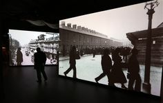 In this exhibition, there are large projections of historical photographs on the walls. Occasionally you see a shadowy figure walk accross the screen.   Titantic Belfast, Belfast Ireland