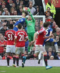 David de Gea of Manchester United in action with John Stones of Everton during the Barclays Premier League match between Manchester United and Everton at Old Trafford on April 3, 2016 in Manchester, England.