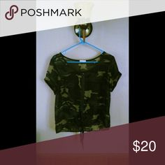 Camo Sheer Studded Top Ties in the front and has studs going down the middle of it in the front. Worn 2x. Tops Blouses