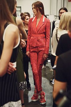 Red and orange speckled suit backstage at Iceberg SS15 MFW. More images here: http://www.dazeddigital.com/fashion/article/21849/1/iceberg-ss15