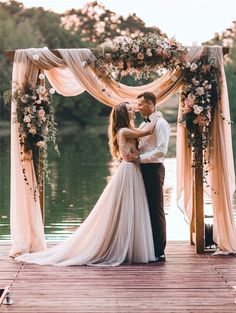 20 DIY Floral Wedding Arch Decoration Ideas Wedding ceremony on a lake!