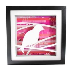 """Songbird Shadowbox (by Amy Gibson) (1/2) - intricately hand-cut songbird set against a rosy-hued collage of discarded pages. Shadowbox is 10"""" x 10"""", frame is 0.75"""" thick and 1.75"""" deep."""