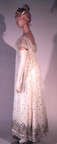 Evening dress, probably from England, circa 1805. White mull cotton dress embroidered with silver thread in a neoclassical mode. Kent State University Museum Silverman/Rodgers Collection KSUM 1983.1.27
