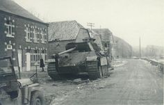 "Photo A5.  German Panther tank knocked out in Hotton, Belgium.  The 3rd Armored Division was engaged against elements of the German 116th Panzer Division ""Windhund"" (""Greyhounds""), in the vicinity of Hotton, Belgium from 21 December 1944 until 26 December 1944.  This tank was part of Kampfgruppe ""Beyer"" of Panzer Regiment 16, a unit of the 116th Panzer Division."