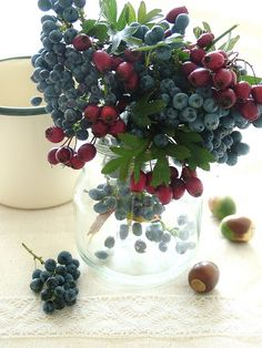I like the idea of using winter berries in the floral arrangements or center pieces.