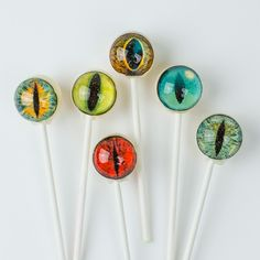 I spy with my creature eye... a delicious treat! These unique lollipops from the folks at Vintage Confections are as creepy as they are tasty. Featuring an assortment of eyeball types and colors, thes