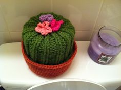 """From the pattern description: """"This TP cozy is knit in-the-round, and covers 2 or 1 rolls of toilet paper."""""""