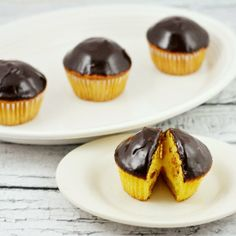 Delicious Boston Cream Pie Cupcakes filled with french vanilla cream and topped with chocolate ganache.