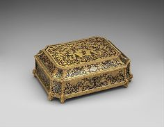 Toilet casket, ca.1700, French. Known in French as a carré de toilette, this rectangular casket has canted corners and is richly decorated in so-called boulle marquetry of brass inlaid with tortoiseshell, mother-of-pearl, and tinted horn (contre partie). Containing ribbons, feathers, or other adornments, boxes like this played a role in the elaborate dressing ritual of the past and would have been placed on the dressing table. See casket  in Nattier's portrait, Madame Madame Marsollier...