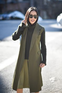 Olive green sleeveless jacket YSL - Dark green sweater HELMUT LANG - Green skirt ALICE & OLIVIA - Sunglasses CÉLINE - 9to5chic