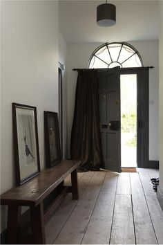 Perfect positioning for the curtain on hall door. Dark colour on interior woodwork too.