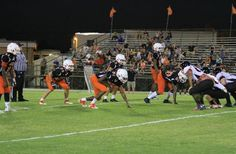 2015 Leesburg Yellow Jackets Football Archives, Umatilla at Leesburg spring game - The Jackets defense lines up against Umatilla's offense during Leesburg's 24-16 victory in the spring game. Thursday, May 21, 2015, (Chris Hays, Orlando Sentinel) Carver Heights Quarterback Club, Leesburg High School, Leesburg, Florida