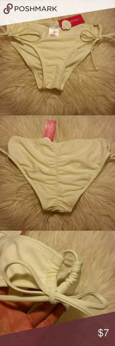 Cheeky xhilaration bikini bottoms never worn New with tags cheeky bikini bottoms, still with tags, tie string sides Xhilaration Swim Bikinis
