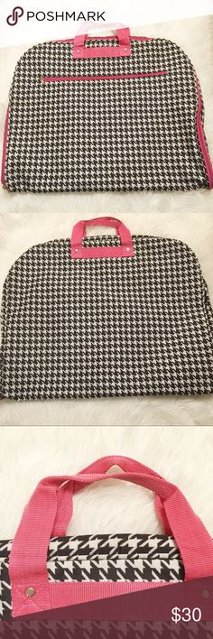 """🆕Houndstooth garment bag 🆕Listing. Adorable black and white houndstooth garment bag with pink accents. Outside zip pocket, inside fully zips open with 4 zip pockets and metal hanging hook.  Polyester, Silver pewter hardware Dimensions Approx 24"""" L x 1.5"""" W x 40"""" H - 1.25 lb. no rips stains or tears, some light wear on handles Bags Travel Bags"""