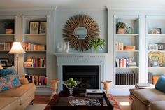 Moldings, bookcases, and walls all painted one color tones down ornate details. From Robin and Jeff's Georgetown home, via Apartment Therapy
