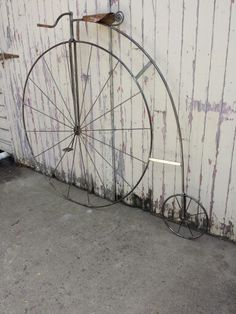 Penny farthing sculpture, with brackets for Café sign