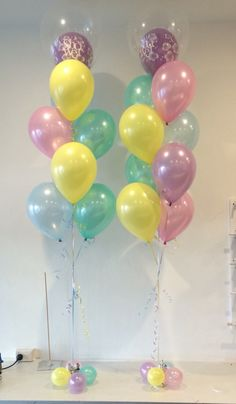 """Beautiful mix of pastel metallic balloons for a baby shower. The top balloon becomes even more of a feature with a printed balloon inside a giant 16"""" diamond clear balloon. We love this floor arrangement for a baby shower and can be easily customised for any sort of event"""