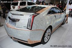Bling! Bling! A one-of-a-kind Cadillac CTS Coupe covered with 350,000 Swarovski crystals was unveiled during the 2011 Qingdao International Auto Show.