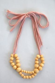 Use a pretty old tee and big wooden beads.