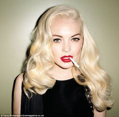 Poser: In keeping with the '50s pinup theme, Lindsay dons bright red lipstick and her usual bleached blonde hair
