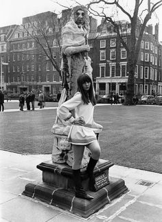 Chrissie Shrimpton in a mini dress and boots.